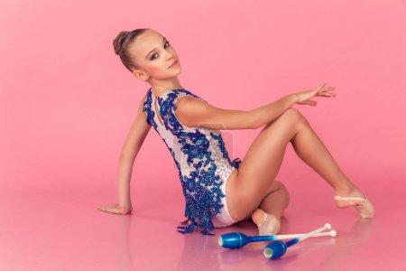 Teenage girl doing gymnastic exercises