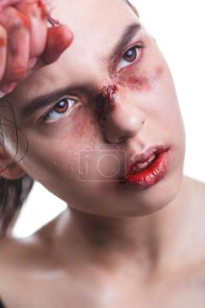 woman with bloody face and hands