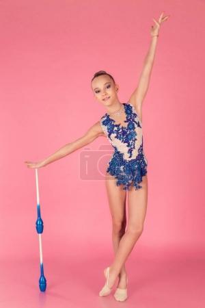 Teenage girl doing gymnastic exercise