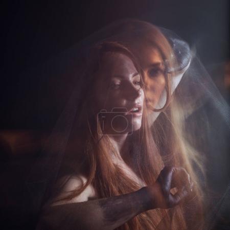 female model posing with black veil