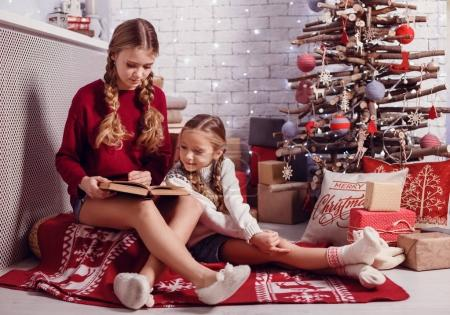 sisters reading book