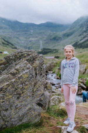 Photo for Young girl posing outdoor in the mountains - Royalty Free Image
