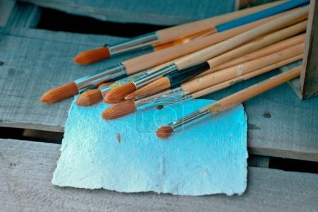 brushes in wooden box