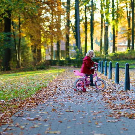 Little girl riding bicycle in the park