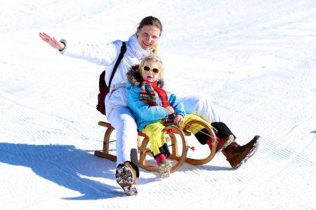 Mother and child enjoying winter holidays