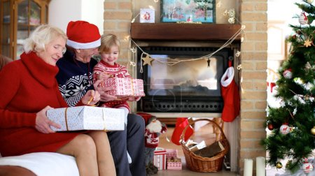 Family exchanging christmas gifts