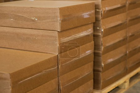 Photo for Brown paper package boxes in a storage room - Royalty Free Image