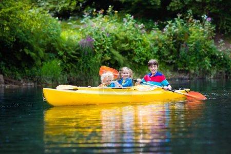 Kids kayaking on a river