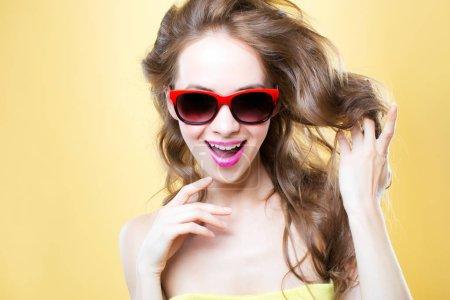 Joyful woman in sunglasses.