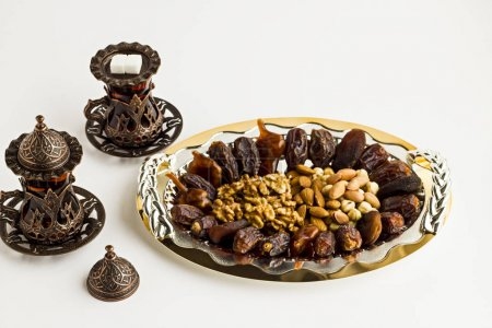 Photo for Close-up shot of delicious dried dates and nuts on plate - Royalty Free Image