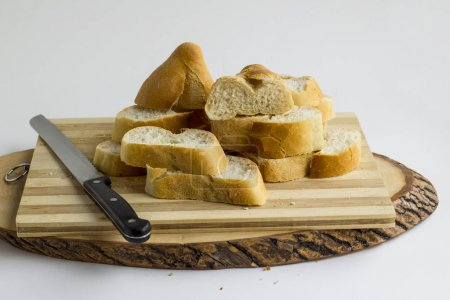 Photo for Close-up shot of delicious freshly baked sliced bread on wooden board - Royalty Free Image