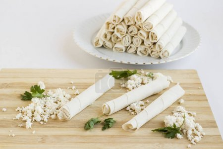 Photo for Close-up shot of delicious rolled crapes with cottage cheese on white surface - Royalty Free Image