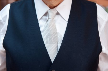 close up detail of an elegant groom's suit