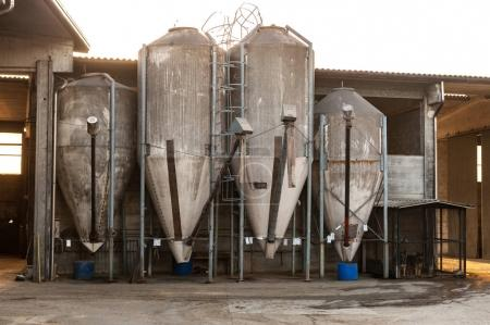 Set of farm silos for grain in a farmhouse