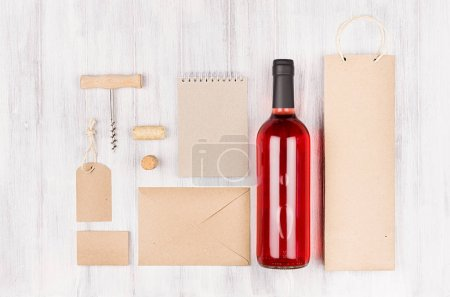 Corporate identity template for wine industry with bottle rose wine on soft white wood background. Mock up for branding, advertising, design, business presentations and portfolios.