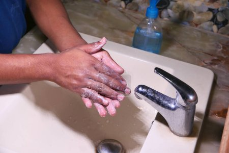 Photo for Hands with soap warm water using hand sanitizer gel. - Royalty Free Image