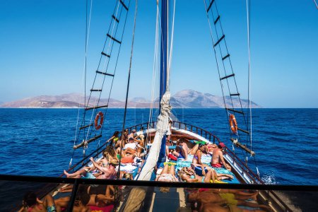 People sunbathing in yacht off the coast of Greece