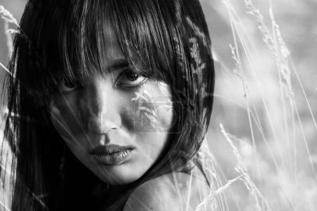 Double exposure of gorgeous girl closeup portrait and field monochrome