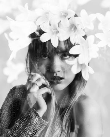 Monochrome double exposure of beautiful girl with freckles and flowers