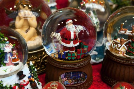 Christmas ball with Santa Claus holding names list and colorful presents