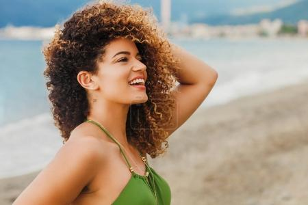Photo for Gorgeous woman portrait smiling on the beach in Summer - Royalty Free Image