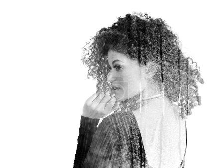 Double exposure of woman back portrait and rain on windowpane, monochrome