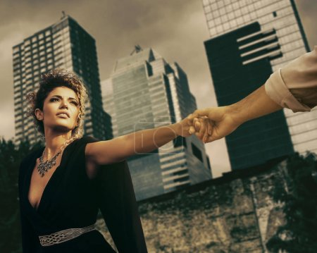 Couple portrait going to separate and dramatic cityscape