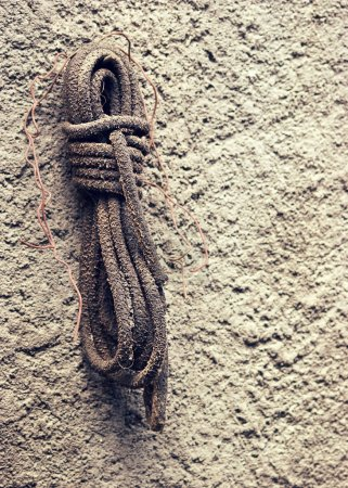 Rolled up rope hanging on the wall