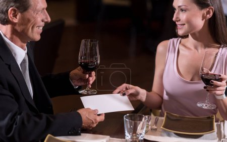 Cheerful couple drinking wine in the restaurant
