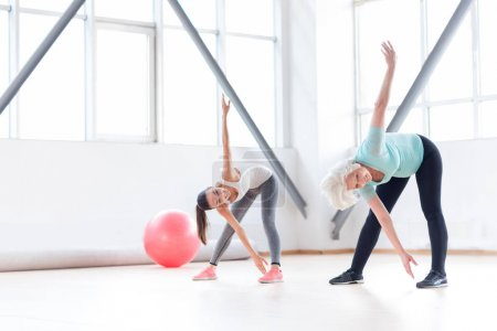 Active cheerful women exercising in a fitness club