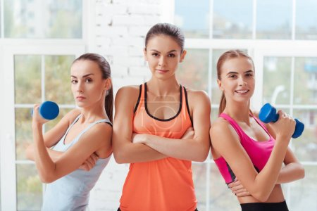 Three active women posing after workout