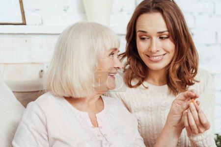 Positive elderly woman taking pill