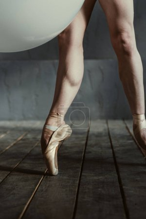 Brawny ballet dancer legs in pointes