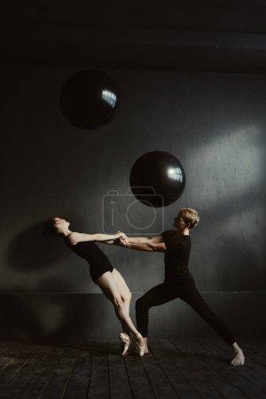 Friendly positive ballet dancers performing in the studio