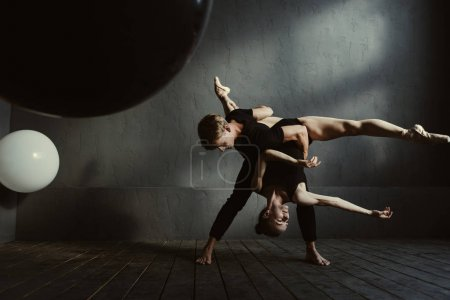Flexible ballet dancers showing their skills