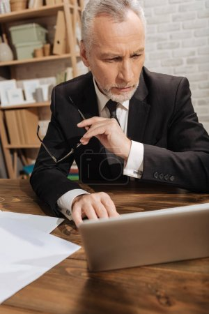 Concerned entrepreneur browsing a document