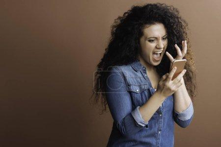Irritated girl crying at phone