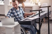 Gifted disabled man recording music on his computer