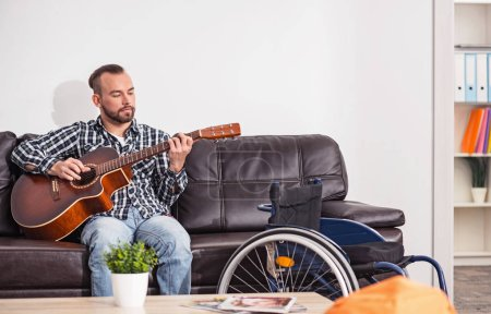 Relaxed musician working on new song