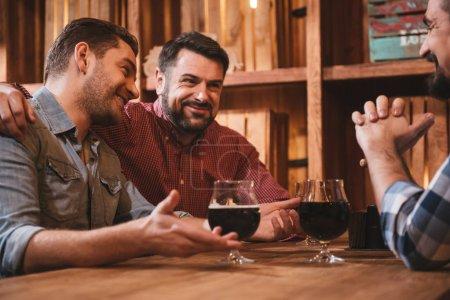 Positive bearded man hugging his friend