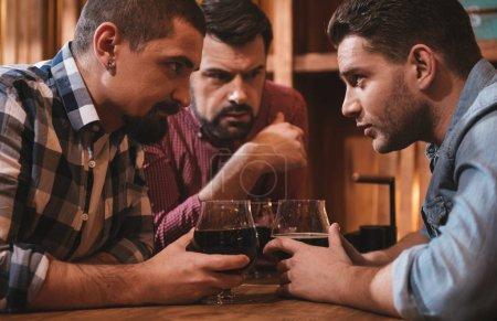 Handsome attractive men exchanging their secrets