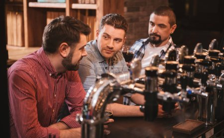 Handsome nice men resting in the bar