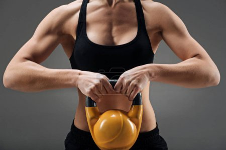 Close up of athletic woman demonstrating gym weight
