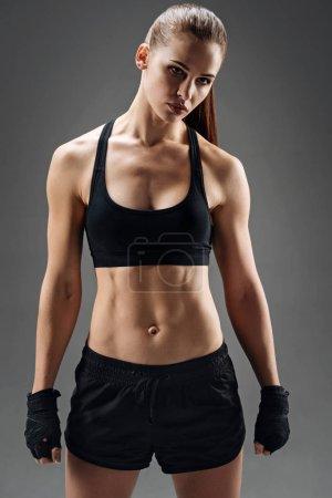 Young woman posing in sportswear