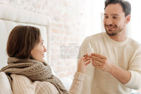 Cute bearded man curing his girlfriend at home