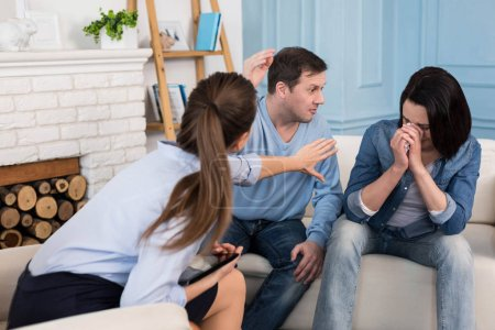 Confident professional psychologist dealing with a family conflict