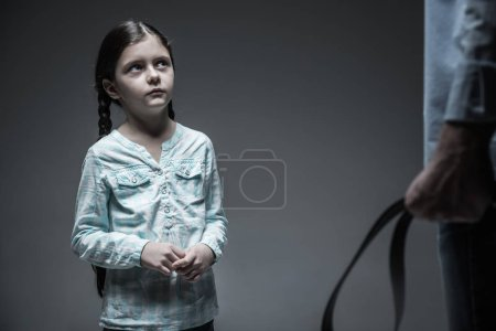 Portrait of scared girl while watching her angry dad