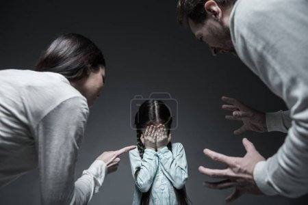 Two elderly persons shouting at little girl