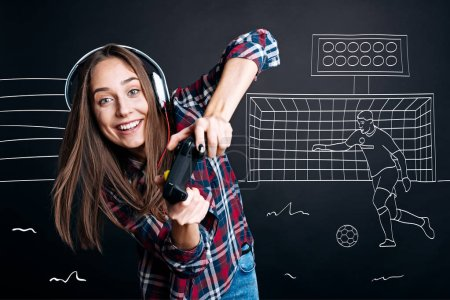 Positive delighted woman playign computer games
