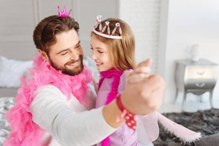happy man dancing with his daughter